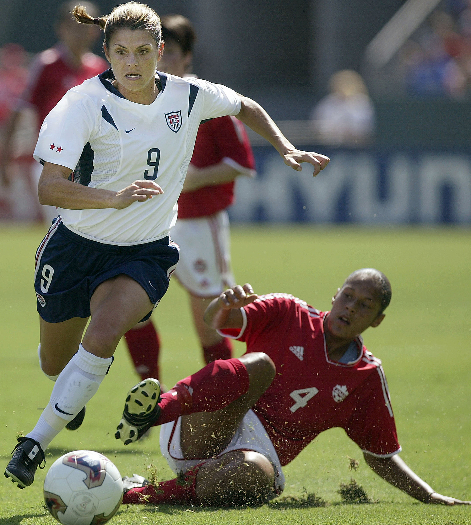 CARSON, CA - OCTOBER 11:  Mia Hamm #9 of the USA dribbles against the defense of Sasha Andrews #4 of Canada during the the third place match of the FIFA Women's World Cup on October 11, 2003 at the Home Depot Center in Carson, California.  (Photo by Jeff Gross/Getty Images)